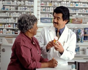 Elderly woman consulting with pharmacist