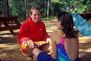 camp counselor talking to girl