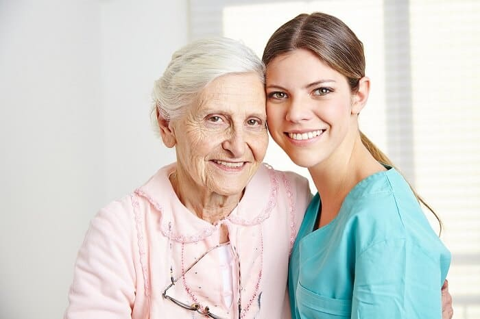 patient care technician posing with a patient