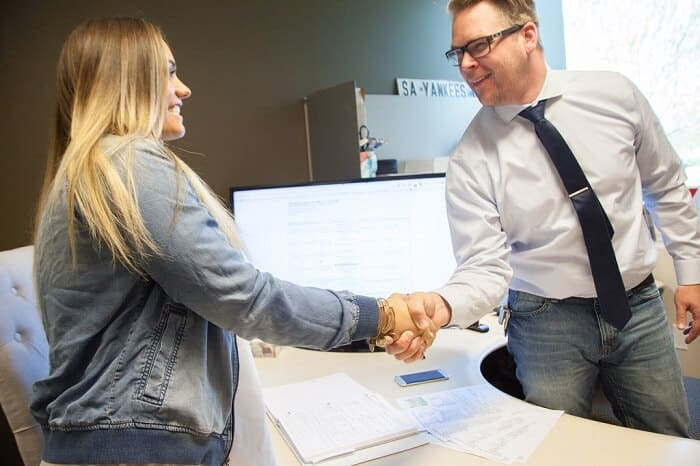 client and insurance agent shaking hands