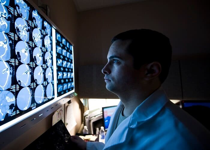 neurologist looking at scans