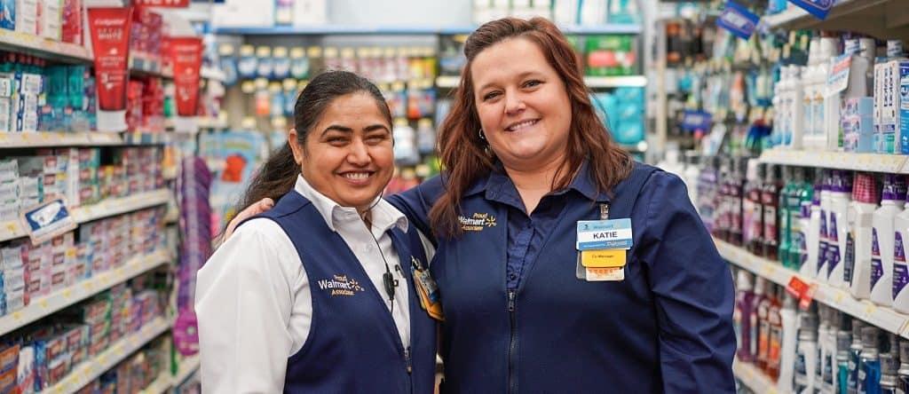 Smiling Walmart sales associates