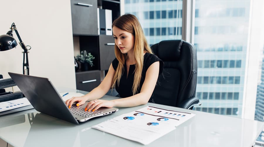 business analyst working using her laptop