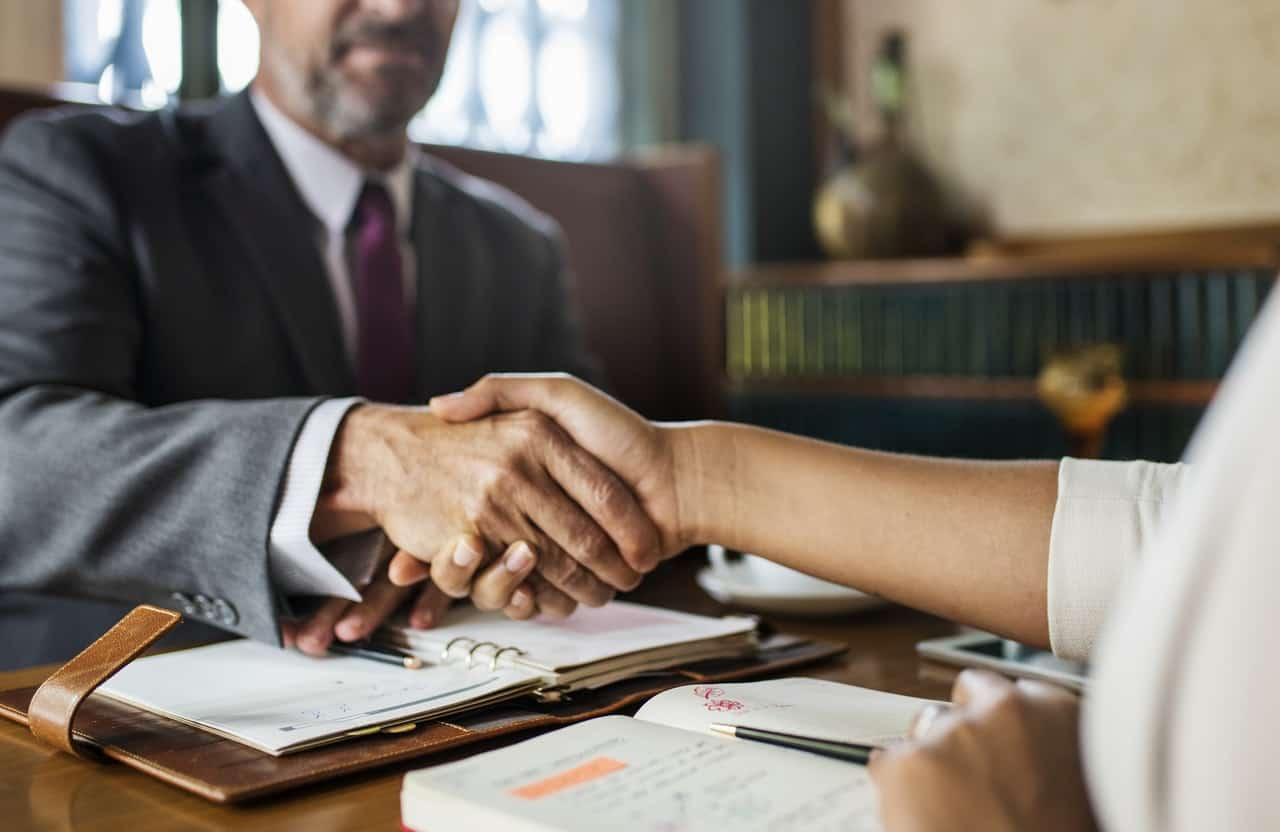 Attorney Handshake His Client In The Office