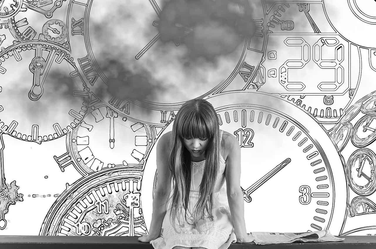 woman anxiously thinking with the timepieces on her background
